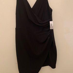 Black mini dress , with split on the side.